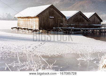 frozen lake boathouse winter cabin traditional alpine life