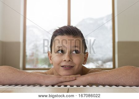 Portrait Of Smiling Teen Boy In A Swimming Pool With Copy Space