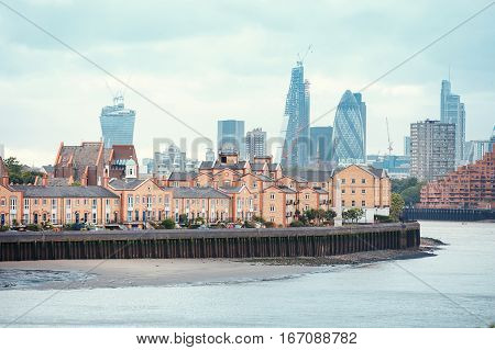 View of London Docklands with the Thames River, downtown  and city center. Real estate buildings suburbs