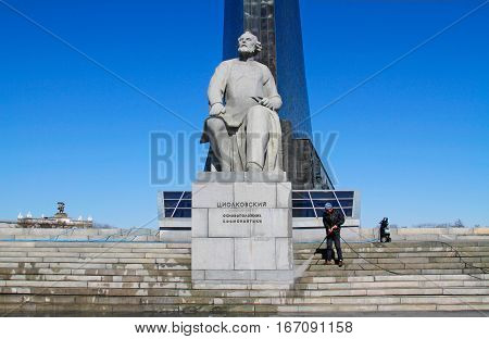 Moscow Russia - April 05 2016: Worker clean with a pressure washer the monument to the founder of cosmonautics Konstantin Tsiolkovsky in Moscow.