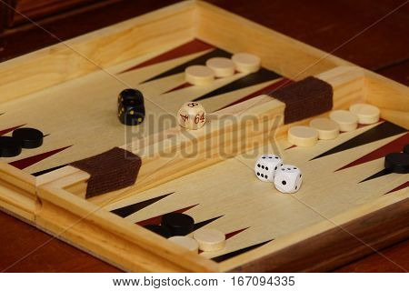 Cubes and  game pieces on a backgammon board