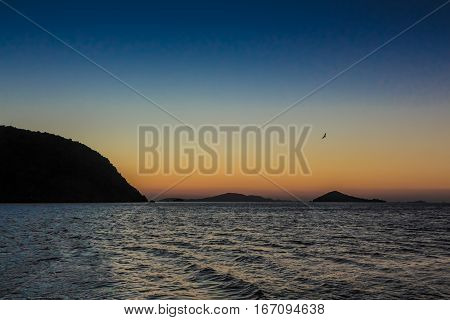 The sun rises over the Greek island of Patmos