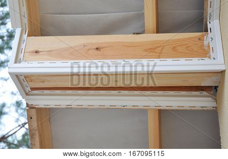 Close up on Install Soffit. Roofing Construction. Soffit and Fascia is Usually Constructed of Vinyl Wood or Aluminum and is Installed on the Underside of Roof Overhangs and Eaves.