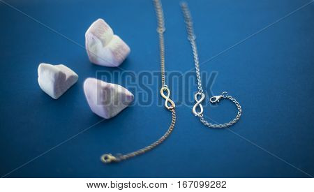 Two chains. Gold and silver chain. Beautiful chain on a blue background