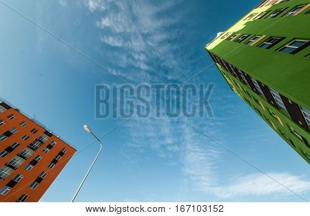 A high-rise building with residential apartments. The photo on the background of the sky