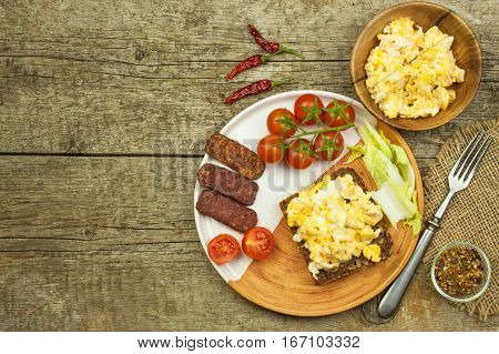 Scrambled Eggs With Bread And Salami. Egg Breakfast On A Wooden Table. Healthy Food.