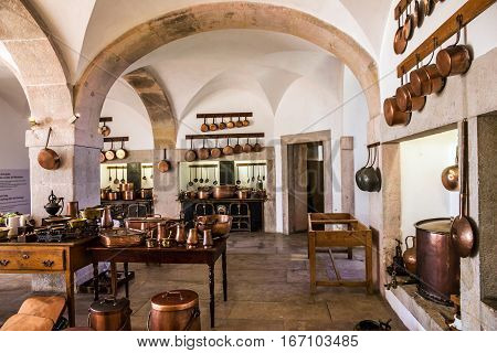 Sintra, Portugal - Jan 13, 2017: Kitchen copper utensil - interior of royal kitchen in National Palace of Sintra, Portugal