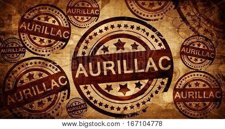 aurillac, vintage stamp on paper background