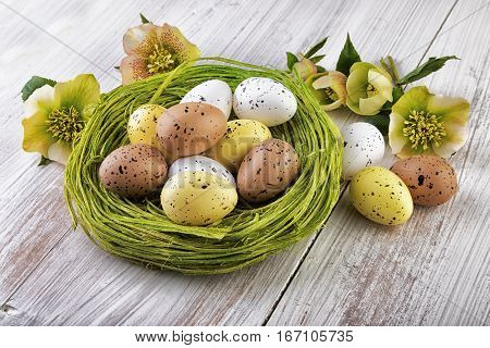 yellow green easter decoration on wooden background