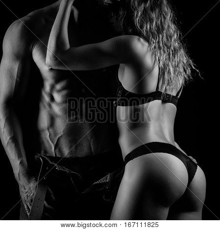Artistic photo of fitness couple hugging. Black and white