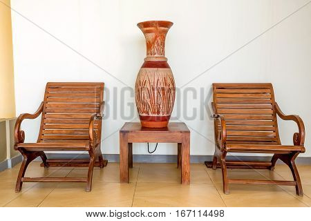 Wooden chairs as part of interior in colonial style