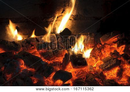 smoldering fire and flames wood. heat and flame of fire in the fireplace