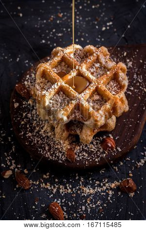 Belgian waffles with nuts and caramel, close-up