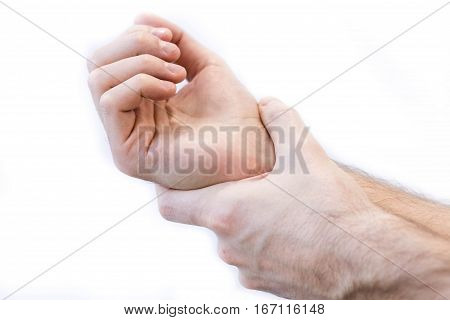 Man holding his hand pain concept low back pain, damaged joint after sport.. isolate on white background