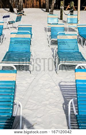Blue and Orange beach recliner chairs at Siesta Key beach Sarasota Florida