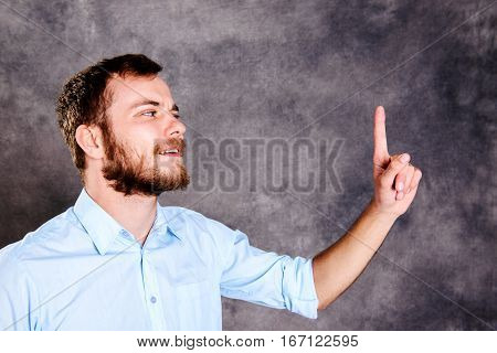 Bearded Man Is Surprised And Showing Forefinger