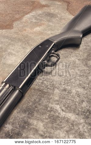 Weapon. Shotgun concept. Black shotgun. Detail. For protection.