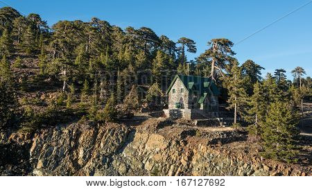 Forest landscape with luxury holiday chalet at Troodos mountains in Cyprus.