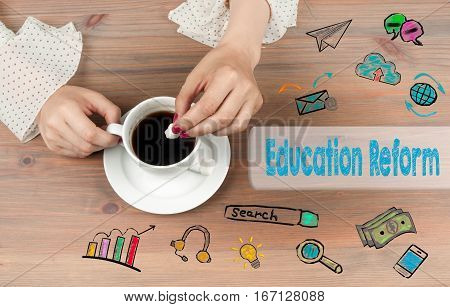 Education Reform. Coffee cup top view on wooden table background.
