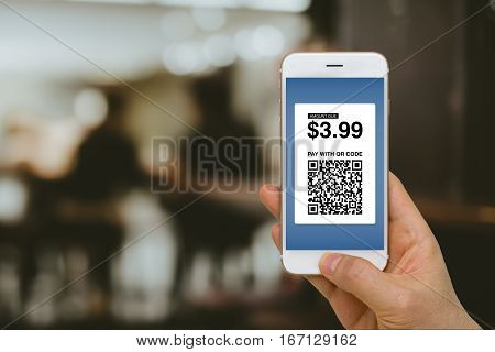 Fintech concept paying for goods and services by smartphone using E-Wallet and E-Money.