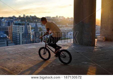 Urban Bike Rider With Modern Building In Background.