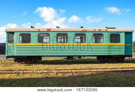 Green narrow-gauge railway wagon . ... .