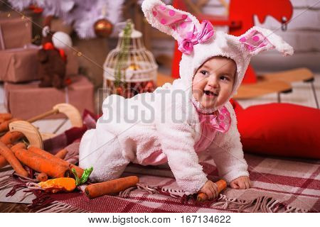 Cute Young Toddler Girl Wearing A Bunny Rabbit Costume Chewing On A Carrot