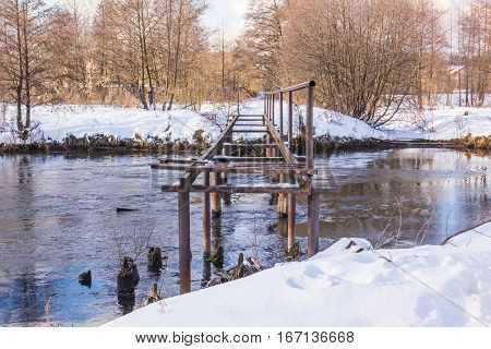 Bridge over small River in Russia - Winter