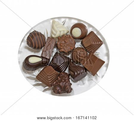 Glass plate with a variety of delicious pralines