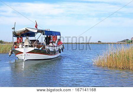 DOLYAN RIVER, TURKEY- APRIL 29, 2012: Pleasure boat motor up the Dalyan river, Turkey