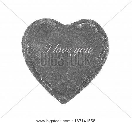 Stone heart on white background with inscription