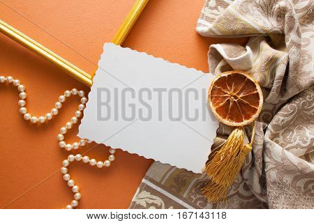 elegant background with beige ornamented drapery and orange