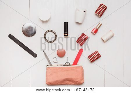 Bottomless female beautician. An infinite number of things stored in handbags. A bunch of cosmetics.