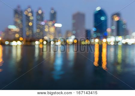 Twilight blurred bokeh lights with office reflection abstract background