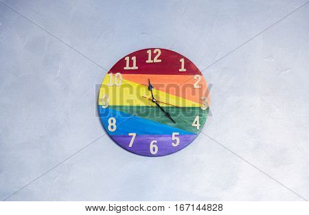 Colorful clock on the wall, red yelow green