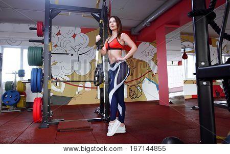 Full Length Shot Of Determined Fitness Woman Walking In The Crossfit Gym. Muscular Sportswoman Warmi
