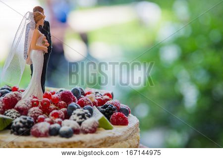 Wedding cake with statuette on the top