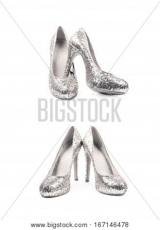 Pair of shining silver high-heeled footwear shoes, composition isolated over the white background, set of two different foreshortenings