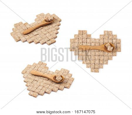 Heart shape made of multiple brown sugar cubes with the wooden spoon over it, composition isolated over the white background, set of three different foreshortenings