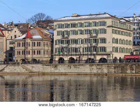 Zurich, Switzerland - 27 January, 2017: historical part of the city and the Limmat river in wintertime. Zurich is the largest city in Switzerland and the capital of the Swiss canton of Zurich.
