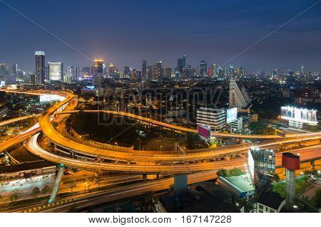 Highway interchanged with city residence downtown background night view