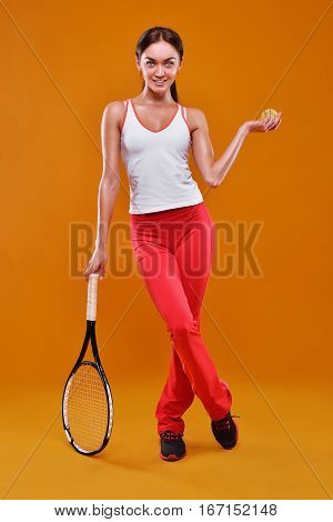 Full Length Portrait Of Young Woman Playing Tennis