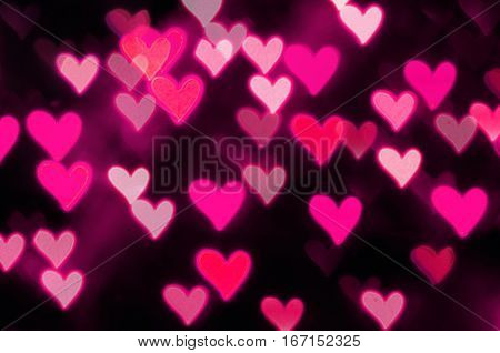 St Valentines Day pink heart bokeh background - St Valentines Day postcard. St valentines day background
