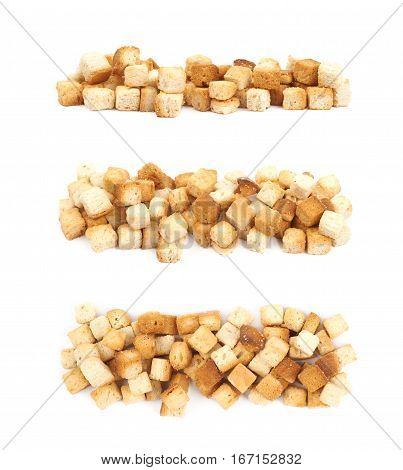 Lined up pile of garlic white bread croutons isolated over the white background, set of three different foreshortenings