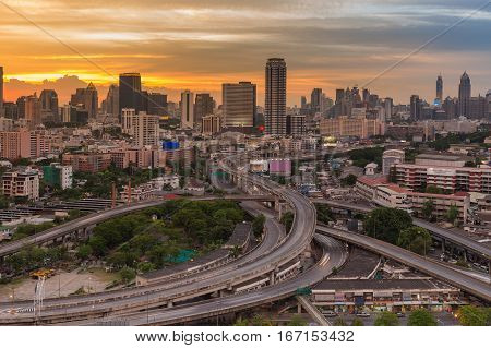 City and interchanged road aerial view with beauty sunset sky background Bangkok Thailand