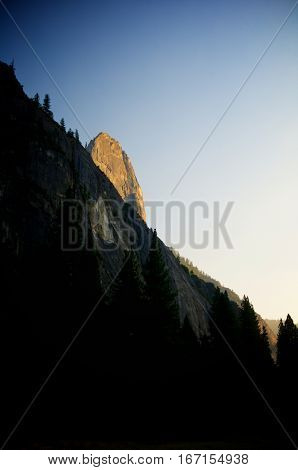 rocky pinnacle with clouds and blue sky in Yosemite National Park, USA