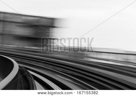 Blurred motion moving sky train black and white tone
