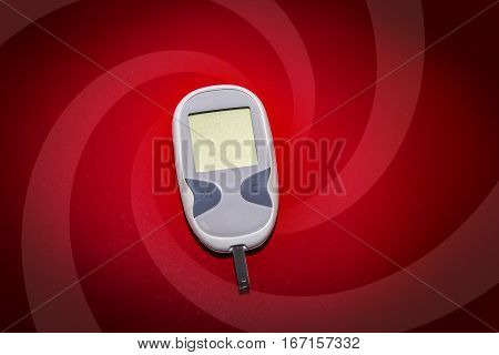 Blank Glucometer On Red Background