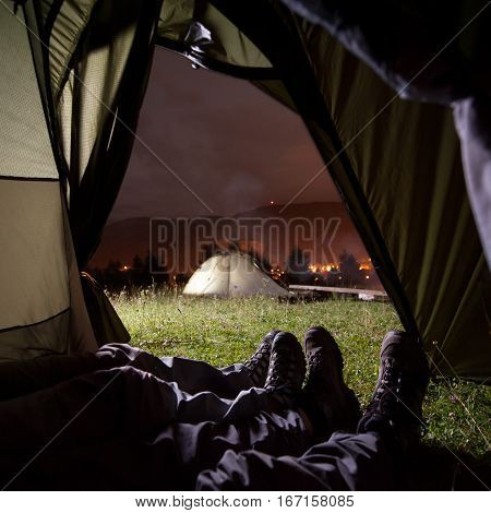 Two People Lying In Tent With View Of Night Camping