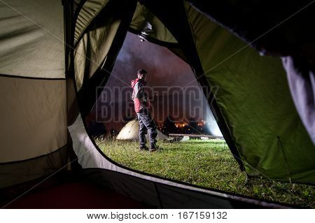 Young Man Standing Near Night Camping